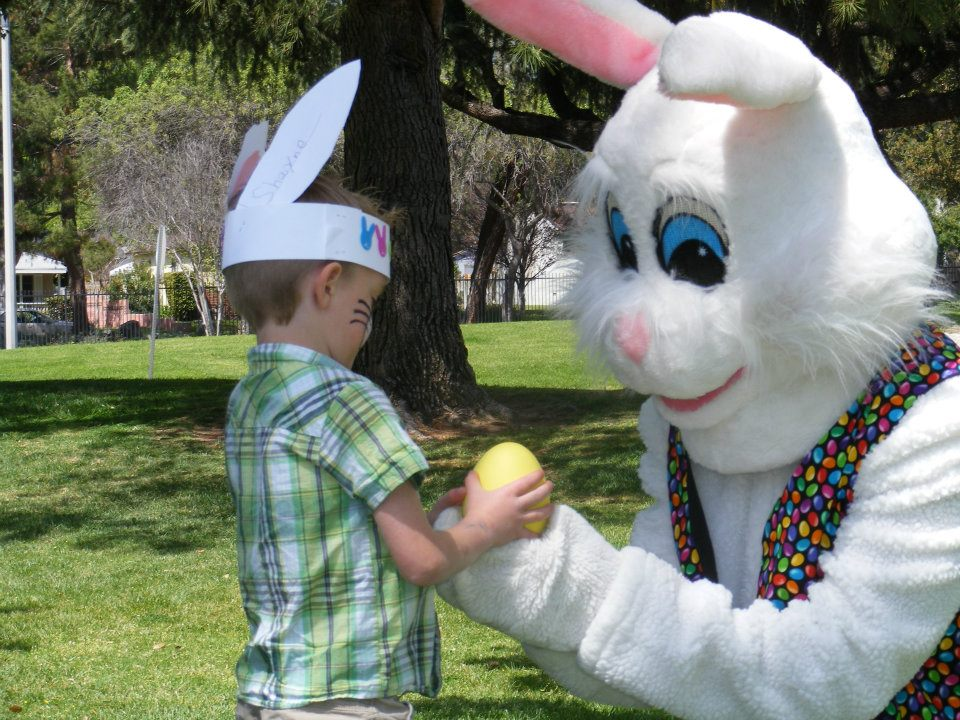 Easter Bunny Helping A Boy With Easter Egg Hunt